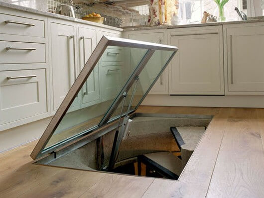 Secret spiral stairs: descend into a hidden space under your kitchen. Photo: thekitchn.com