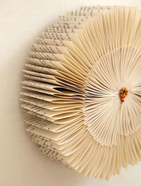 Folded book pages wall decor