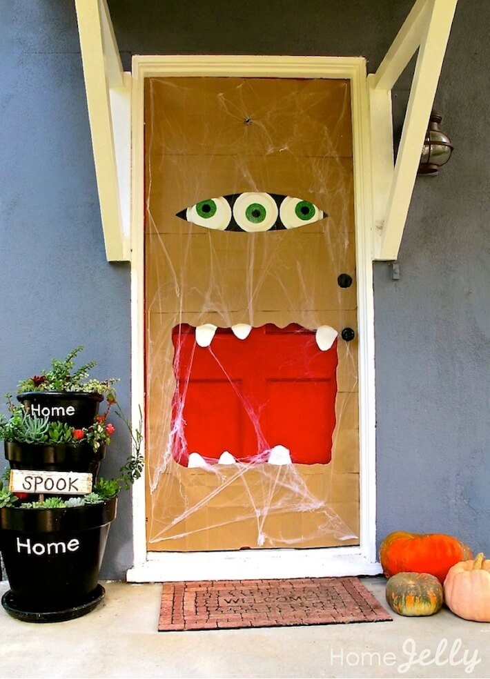How to make a halloween paper bag door monster homejelly for Decoracion de halloween