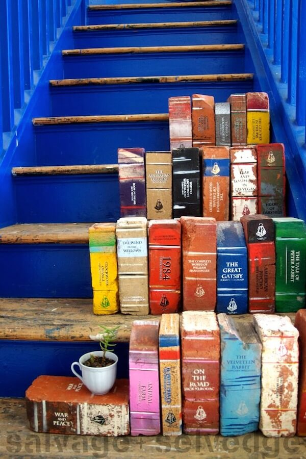 Brick books on a blue staircase