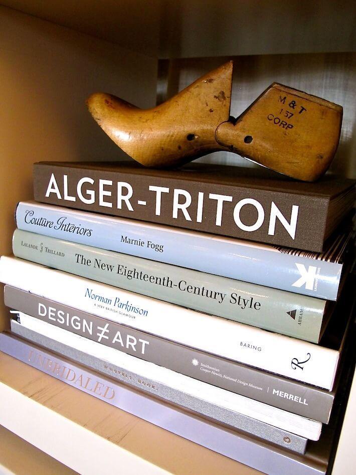 Design books and vintage shoe form