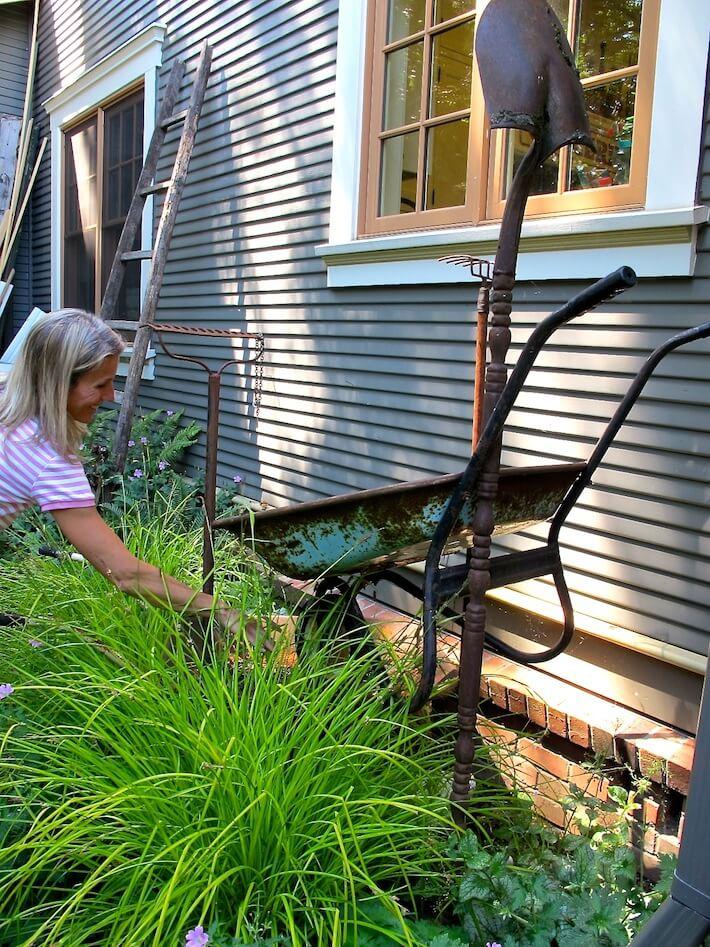 Wheel barrel and garden tools water fountain