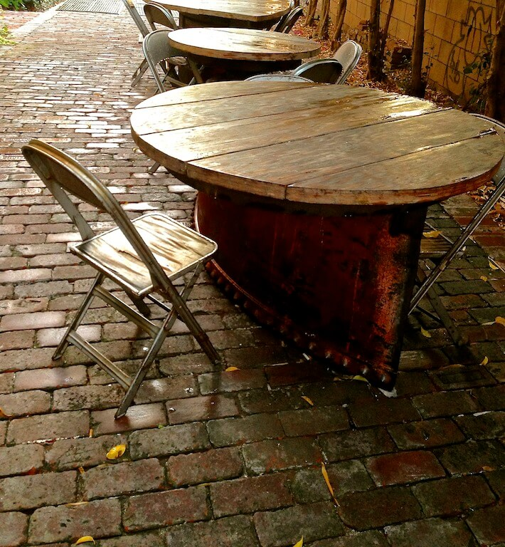Reclaimed and repurposed metal container tables