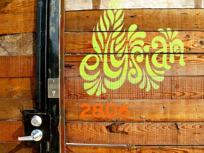The Elysian front gate signage