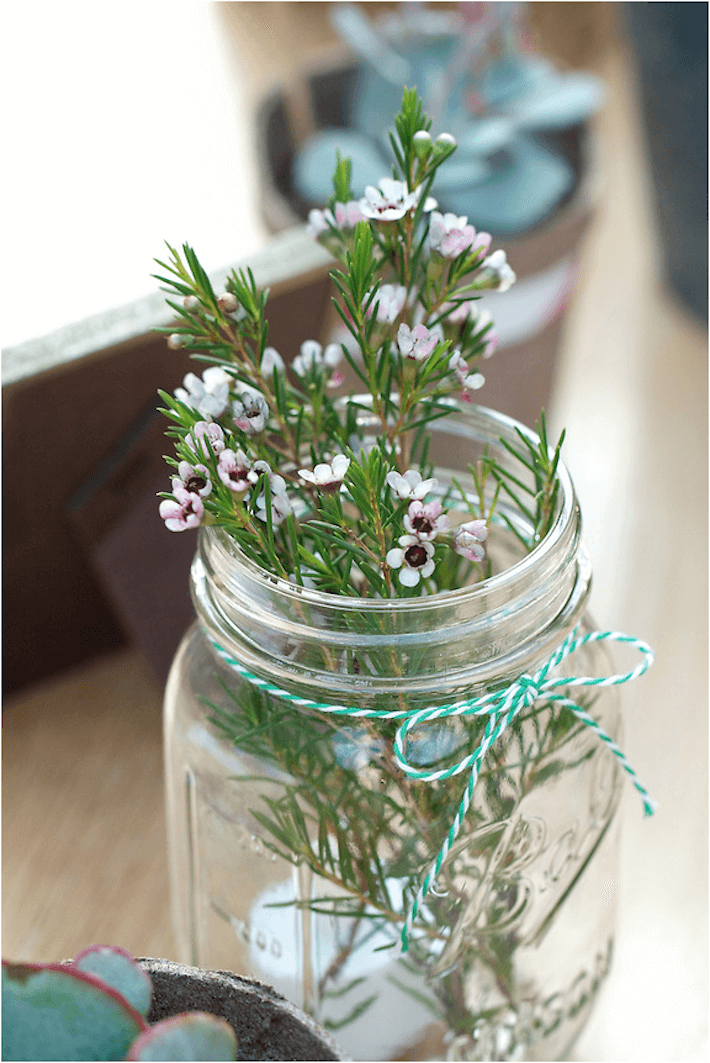 Mason jars with wax flowers