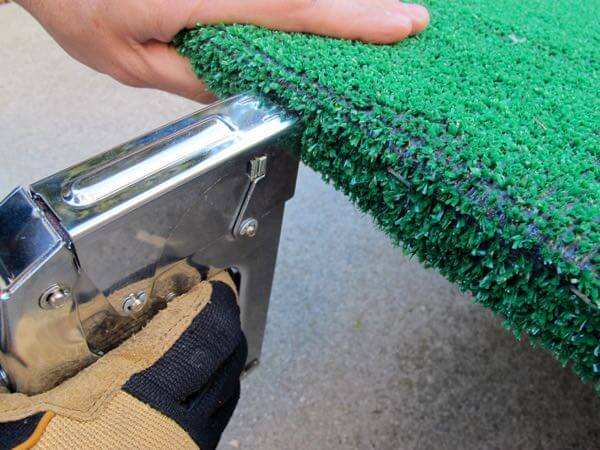 Staple your artificial turf to the topside of the ramp