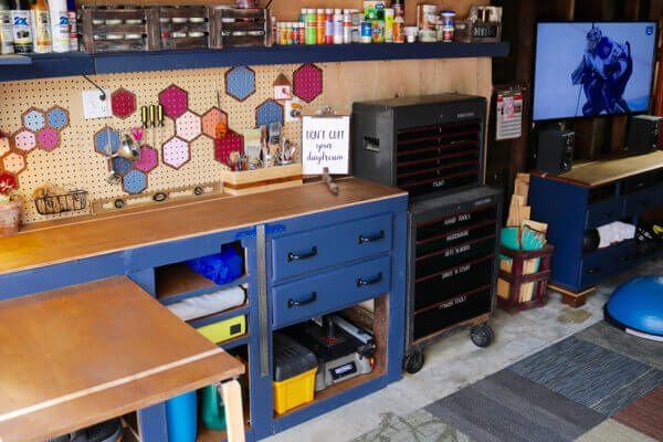 Workbench, folding table and gym cabinet now match and unify the entire garage space 2