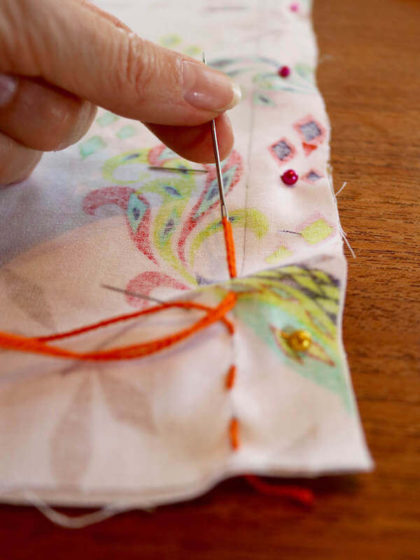 If you don't have a sewing machine, hand stitch a stright stitch using embroidery thread
