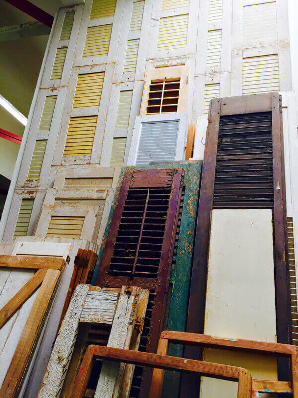 Shutters of all sizes, styles and colors salvaged from neighborhood homes