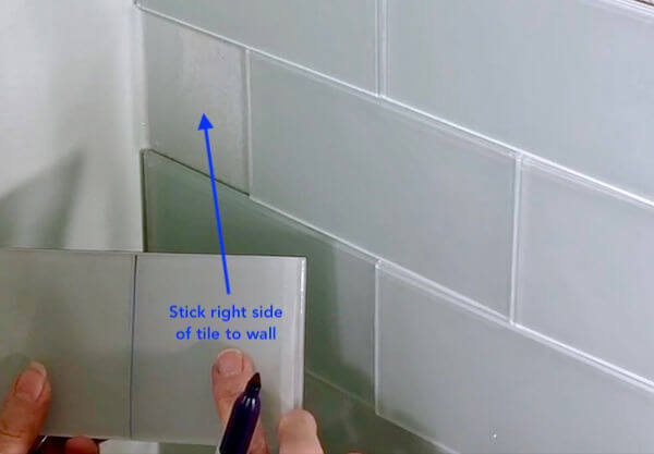 Mark and -x- on the LEFT side of the tile. Stick the RIGHT side to fill in the corner