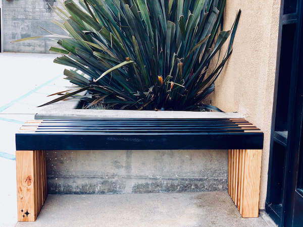 Slatted bench side view