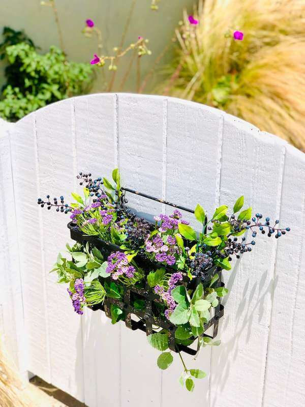 Refreshed garden gate with floral basket...cuteness, check!