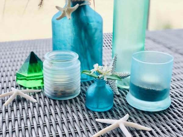 DIY Sea Glass bottles, votives and vases closeup horizontal