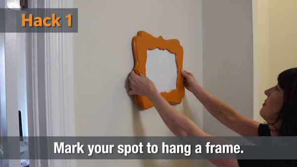 One of five fresh toothpaste home hacks - marking a spot to hang a frame