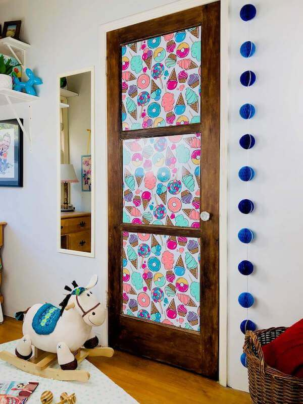 Adding removable wallpaper to paneled doors creates a natural frame for fun designs like this Candy, Donuts, Sweet Ice Cream paper
