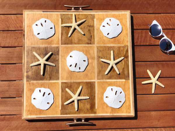 Coastal Tic-Tac-Toe with starfish x's and sand dollar o's