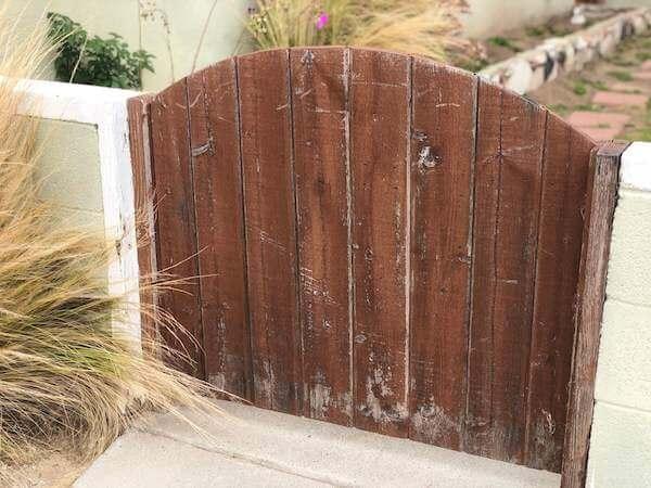 Weathered garden gate still has hope for cuteness