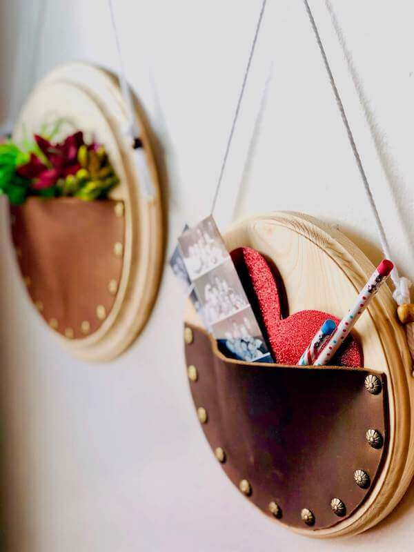 leather wall hangings with items inside